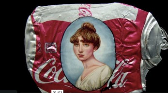Coke can with ancient woman